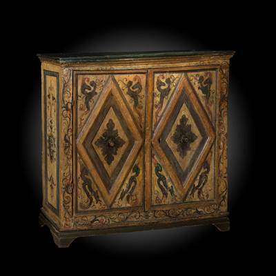 A painted buffet, decoration with fantastic animals and losanges, 2 doors, Umbria, Italy, early 17th century (117 cm wide, 100 cm high, 28 cm deep)