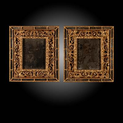 A pair of carved and gilded mirrors, original mercury mirrors, Italy, 17th century (76 cm high, 67 cm wide, 7 cm deep)