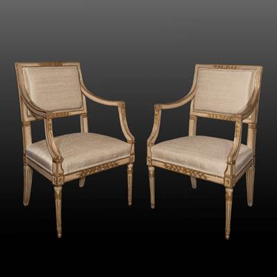 A pair of carved, gilded and ivory lacquered wood armchairs, Naples, Italy, late 18th century, covered in silk (90 cm high, 57 cm wide, 57 cm deep) (35 in. high, 22 in. wide, 22 in. deep)