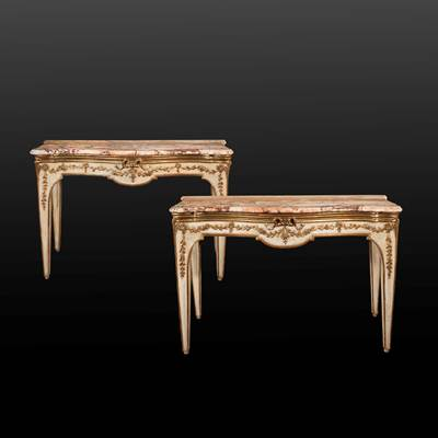 An exceptional pair of gilded and lacquered consoles, each with