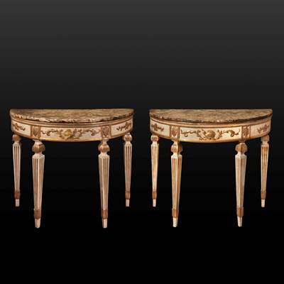 A pair of ivory painted and gilded wood demi-lune consoles, the top in lumachella marble, Tuscany, Italy, late 18th century (104 cm wide, 89 cm high, 53 cm deep)