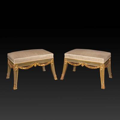 A pair of lacquered and gilded wood stools, Italy, early 19th century (70 cm wide, 43 cm high, 51 cm deep)