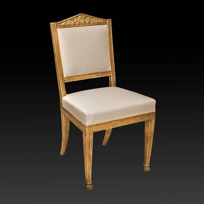 A carved and gilded chair, Tuscany, Italy, circa 1820 (93 cm high, 48 cm wide, 50 cm deep)