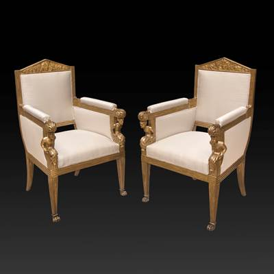 A pair of carved and gilded armchairs, Tuscany, Italy, circa 1820 (104 cm high, 68 cm wide, 60 cm deep)