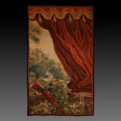 A fine wool and silk tapestry, a parrot under a red velvet curtain, Aubusson, France, 18th century (225 cm high, 137 cm wide)
