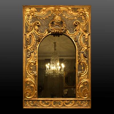 A spectacular carved, gilded and silvered mirror, Italy, early 18th century (212 cm high, 141 cm wide)