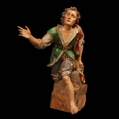 A carved and  lacquered wood sculpture, Genoa, early 18th century (90 cm high, 45 cm wide, 70 cm deep) (35 in. high, 28 in. deep)