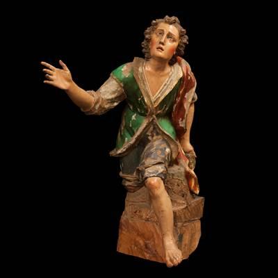 Scultura in legno policromo rappresentante un giovane inginocchiato, Genova, inizi 18° secolo (altezza 90 cm, larghezza 45 cm, profondità 70 cm)