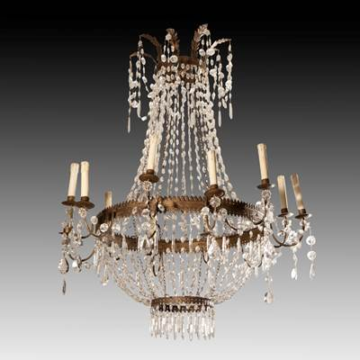 A crystal glass chandelier, 12 arms of light, Italy, early 19th century (110 cm high, 90 cm diameter)(43 in. high, 35 in. diameter)