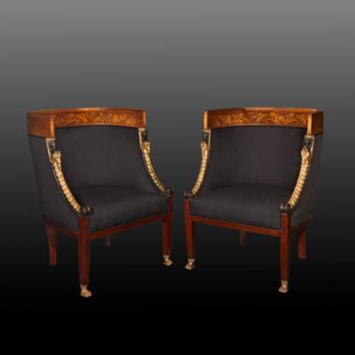 A pair of lacquered, gilded and carved wood armchairs, Lucca, Tuscany, early 19th century (95 cm high, 68 cm wide, 65 cm deep)