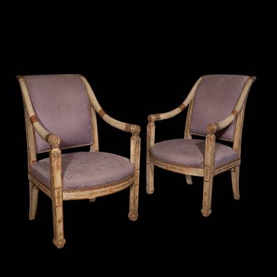 A pair of lacquered, gilded and carved wood armchairs, Naples, early 19th century (94 cm high, 62 cm wide, 65 cm deep)